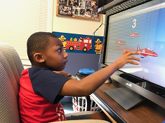 boy plays on computer