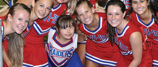 Hailey and cheerleaders at football game